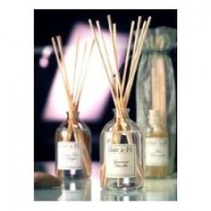 home-made reed diffusers: recycle the bottle and reeds from a commercial product, add your own perfume mixed with baby oil, jojoba oil, or sweet almond oil
