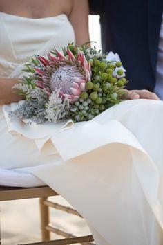 Giant Protea bouquet | Read More: http://www.stylemepretty.com/little-black-book-blog/2014/06/10/hong-kong-beach-wedding/ | Planner: blisscreations.asia | Photography: Derek Ko - derek-photography.com