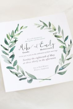 Green watercolor wreath invites. Stationery: Kae & Ales.