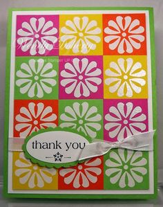 handmade quilt card .... reminds me of Hawaiian quilt appliques ... inchie squares with white emboseds stylized flower head ... colors run diagonally down ... bright tropical colors ... makes me smile ... Stampin'Up!
