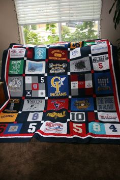 Tshirt quilt memory blanket   great idea since im such a pack rat with this kind of stuff..