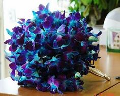blue orchid bouquet for the bridesmaids