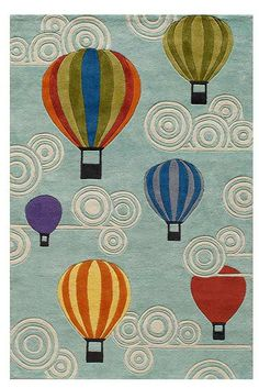 Let your imagination take off: our sculpted Hot Air Balloon Indoor Area Rug invites a colorful group of balloons and windy swirls to take the floor of your child's playroom or nursery.