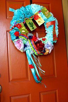 Door wreath idea at a Mexican Fiesta / Cinco de Mayo themed party via Kara's Party Ideas | KarasPartyIdeas.com