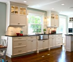 Pretty white kitchen with farm sink