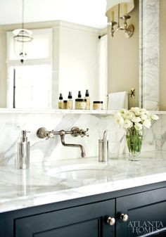 Dark cabinetry and wall mounted faucet