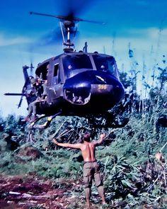 Huey Helicopter Landing In Vietnam. Door Gunner.