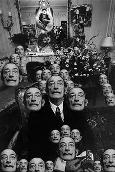 Dali heads. Unknown if this was done by Dali or by another artist...
