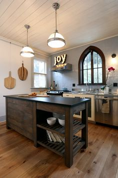 eclectic kitchen by Arciform - Love the window.