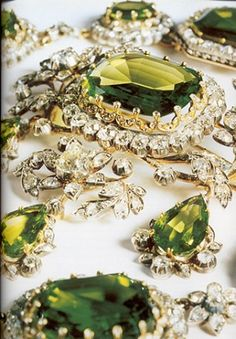 Close up of the peridot parure created in 1820 by Köchert, for Henriette, wife of Archduke Charles, Duke of Teschen.  The parure consists of a diadem, a necklace, a corsage ornament and earrings in peridot and diamonds.  Worn by Archduchess Isabella (née Princess of Croy) at the coronation of the last King of Hungary in Budapest in 1916.