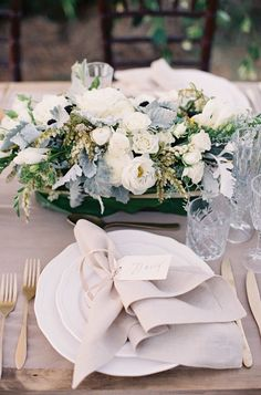 Wedding Centerpiece --ivory and gray and green -- love the natural charm! More on SMP: http://www.StyleMePretty.com/2014/02/10/rustic-chic-australian-shoot-at-gurragawee/ Photography: Feather + Stone
