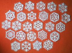 Paper Snowflakes Tutorial- Shows how to cut the paper to make all these different snowflakes!