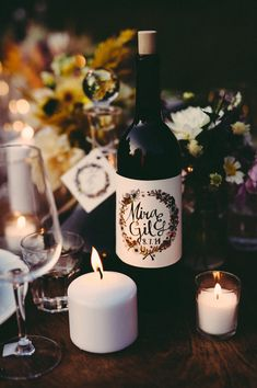 personalized wine bottle favors, photo by JBM Weddings http://ruffledblog.com/handsome-hollow-wedding-ideas #weddingfavors #weddingideas