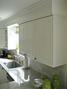 Benjamin Moore Simply White with Ikea Lidingo - also notice this scheme for crown molding with bulkhead - thin molding right above cabinets, then thick molding at the ceiling. Makes the bulkhead look like part of the molding!