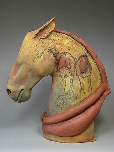 Title: Belgian II  Artist: meagan kieffer  Date: 2007  Technique: handbuilt sculpture  Temperature: Cone 03  Glazing / Surface Treatment: colored slips & glaze  Material: Earthenware