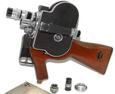 Gun camera-  Actually this was used by reporters during the Vietnam War. The camera is mounted on a rifle butt with a black case and 5x lenses. It's a gadget that belongs in a museum as it is part of camera and American history.