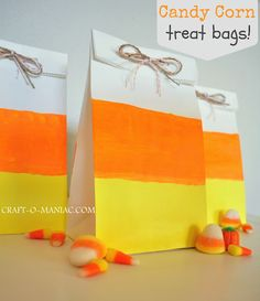 white paper bags painted to be Candy Corn Treat Bags! #Halloween #craft