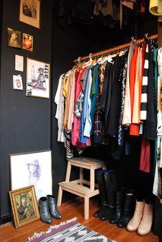 Beautiful dark walls in a neat and tidy closet!