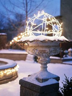Snowy topiary  Your garden urns are filled with color the rest of the year, but are left empty all winter. Make a topiary of light by wrapping miniature white bulbs around a wire form. Consider using battery-powered lights so you can place these throughout your gardens without having to run yards and yards of drop cords. outdoor decorations, balls, outdoor christmas decorations, white lights, christmas lights, lighting ideas, topiari, christma light, garden
