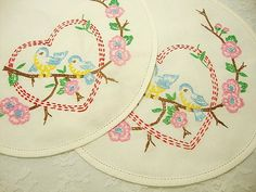 Vintage hand-embroidered doilies with bluebirds
