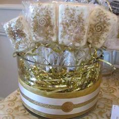White chocolate rice krispie lollipop treats.  I made them to match the gold theme and decorated the glass bowls with coordinating ribbon.  I did the same for the white chocolate covered pretzels I made.