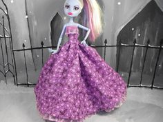 Abbey is taking a little break from the ghoulish fashions to enjoy an homage to spring in this simple cotton dress. Purple flowers with pinkish