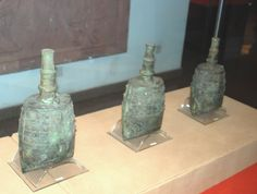 Close up view of three bronze bells buried in the tomb of the Nanyue King, Guangzhou, China, Western Han Dynasty.