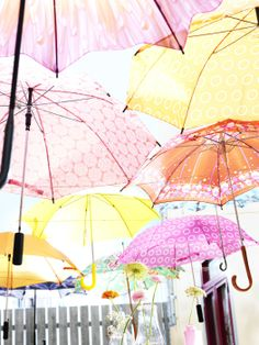 """What says """"Happy Wedding Shower!"""" better than a canopy of brightly colored umbrellas?"""