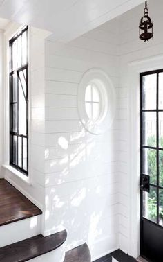 Love the black door, window, dark floors and the planked walls.  Perfection!