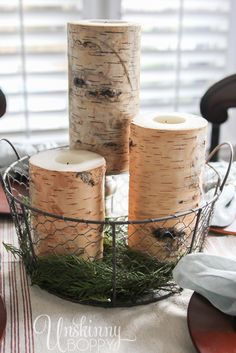 Birch Log candles in a wire basket make a simple holiday tablescape
