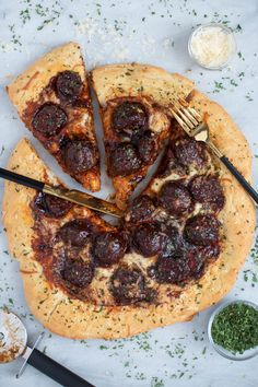 This Texas BBQ Sriracha Meatball Pizza is the best meatless pizza you'll ever taste! It comes based in a spicy-sweet marriage of BBQ + Sriracha sauces, maple syrup and loaded with mozzarella cheese for a beautiful gooeyness in every bite. It's the perfect vegetarian and weeknight meal for the entire family and it's bursting with savoriness and flavor. Easy homemade crust, well seasoned, and made in just 30 short minutes. #pizza #veganmeatballs #meatballpizza #weeknightdinner #weeknightmeals