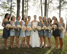I really don't see any reason why the bridesmaids should have to match. If they all have dresses of the same shade, that's good enough for me. Although I love blue, green might also look nice for an outdoor wedding. Even sundresses would look cute!