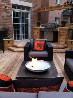 """A custom-built barbeque nook with counter space and decorative aerial beam, from """"Decked Out"""" episode """"The Sideways Deck"""". Deck Design by Paul Lafrance."""