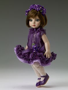 """$139.99 Pretty Party Patsy - Dressed doll  Face includes hand-painted details  Fine quality vinyl and hard plastic  New Patsy® head sculpt  10"""" bend knee child body  Cameo skin tone  Blue/green inset eyes with applied eyelashes  Brown non-removable saran wigged hair  Purple ruffle lace dress with purple faux flower decoration on attached belt and a lavender attached slip with lace trim  White lace tights with attached panties  Purple headband with faux flowers  Purple faux leather shoes  LE 300"""