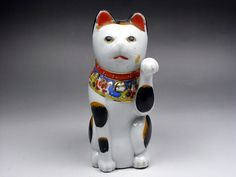 Maneki Neko - Painted Porcelain. Circa Early 20th Century.