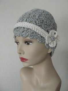 Hand crocheted wool cloche with flower and button accent