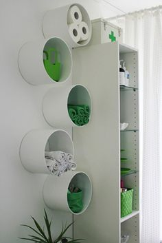 PVC tubes to the wall as neat hanging racks
