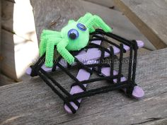 Popsicle stick spider web.  I think Sophie would love this!  A home for her pretend spiders.  Glue popcicle sticks in a snowflake shape then weave yarn around them using glue to secure.