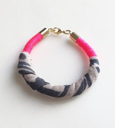 Neon pink printed fabric wrapped bracelet by plaitknot on Etsy, $12.00