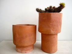 pair of terra cotta flower pots.