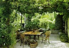 Curved pergola, hedges and low sitting wall.