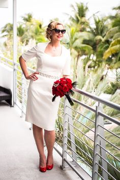 Bride Megan in a short, 3/4 sleeve couture wedding gown inspired by Marilyn Monroe. Wedding dress by Janice Martin Couture - www.janicemartin.net / Photo by Ricky Stern Photographer - www.miamiphotographer.net