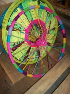 Upcycled bike wheels.  Dream catcher?