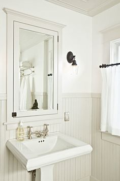 Suzie: Jessica Helgerson Interior Design - .Small chic cottage bathroom white pedestal sink, ivory beadboard, ivory medicine cabinet with mirror and white sheers.