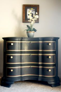 Painted in Graphite (a slate black) by ASCP with details in Chateau Gray and Scandinavian Pink. Interior drawers also painted in Scandinavian Pink.