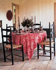 Red Damask  An ornate, vividly colored fabric, such as this Turkey red damask tablecloth, instantly adds warmth and a sense of refinement.