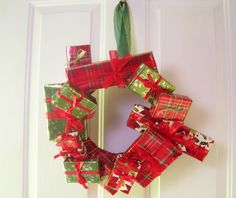 A Christmas wreath made out of little gift boxes. You could really be sneaky and put actual presents inside the boxes, hang the wreath indoors and send them on a hunt to find their gifts. At least that would keep them busy while you prepare Christmas breakfast. #christmaswreath