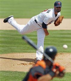 Nick Blackburn delivers to Baltimore Orioles batter Robert Andino