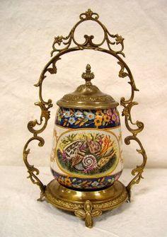 """Biscuit Jar in brass holder. 14"""" tall, 9"""" wide"""