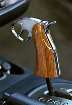 Pistol grip shifter why not...;)  I want one for the Jeep!!  But I want one of a Colt 1911.
